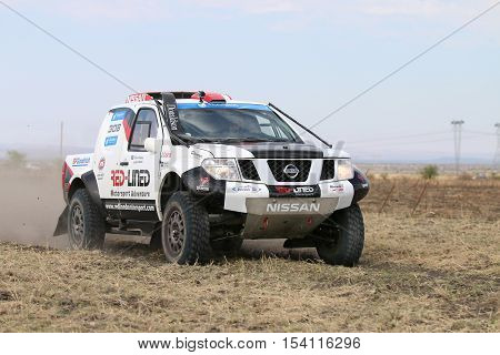 Forty Five Degree Close-up View Of Speeding White And Black Nissan Navara Rally Car