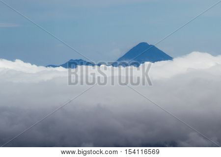 Arenal Volcano Peaking Thru The Clouds