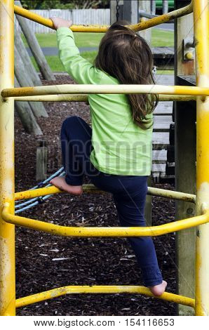 Girl Play In A Playground