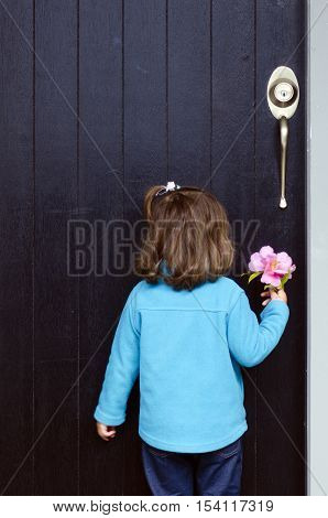 Little Girl Holds Flower