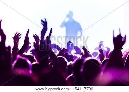 Close up of hands of a young woman at concert, small depth of view,