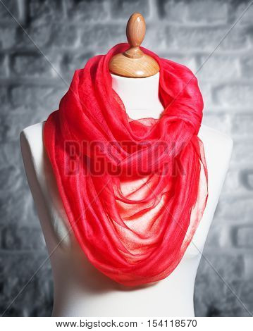 Mannequin with silk cloth. Knitted fashion red organza shawl on tailor bust