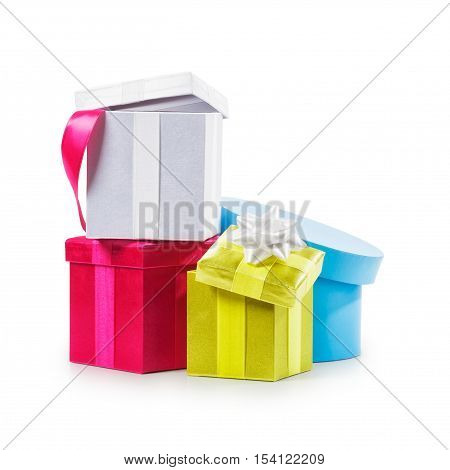 Stacked colorful gift boxes with ribbon bow. Holiday present. Croup of objects isolated on white background. Clipping path