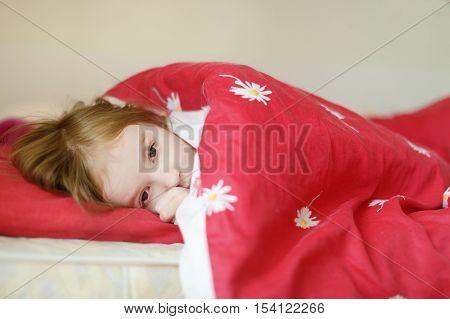 Little Preschooler Girl In Bed