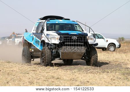Close-up View Of Speeding White And Blue Toyota Hilux Twin Cab Rally Car