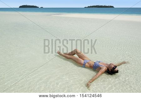 Young Woman Tanning On Aitutaki Lagoon Cook Islands
