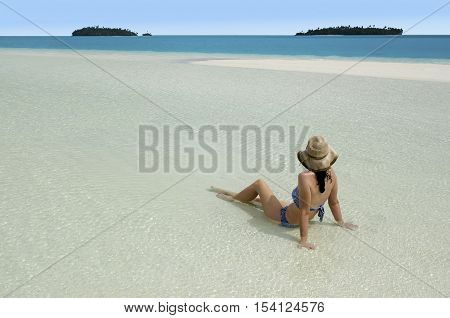Young Woman Relaxing On Aitutaki Lagoon Cook Islands