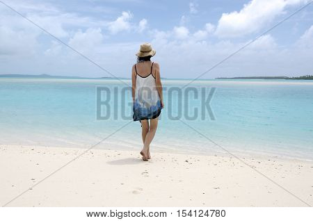 Young Woman Walks Barfoot On Deserted Tropical Island