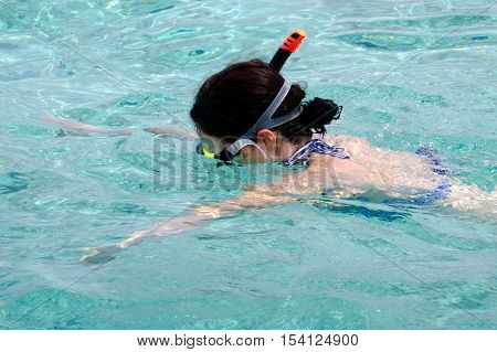 Woman snorkeling in Aitutaki Lagoon Cook Islands