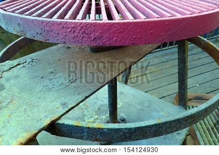 Industrial pink and aqua spray painting wheel at a foundry - abstract beauty