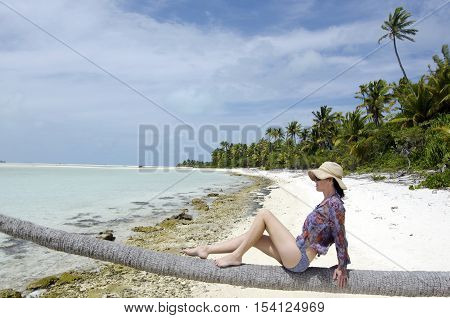 Young, Sexy Woman Relaxing On Deserted Tropical Island