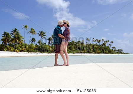 Young Couple Kisses On Deserted Tropical Island