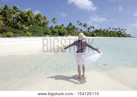 Young Woman Enjoys The Serenity Of A Deserted Tropical Island