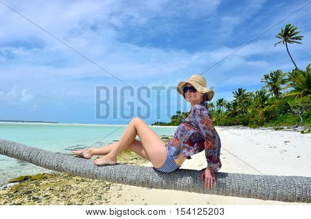Young Sexy Woman Relaxing On Coconut Palm Tree