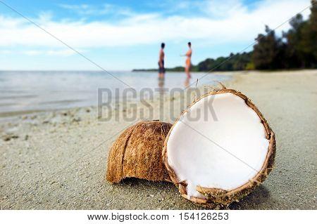 Opened Coconut On Sandy Beach