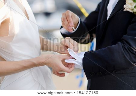 Bride Helping Her Groom With His Cufflinks