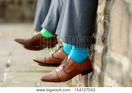 Funny colorful socks of groomsmen on wedding day