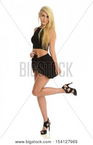 Fashion young woman wearing a short black skirt isolated on a white background