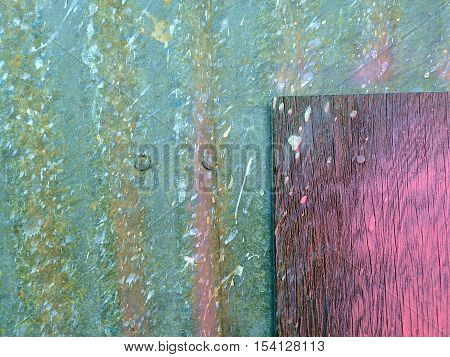 Abstract industrial fiberglass painted door close-up with pink weathered wood inset