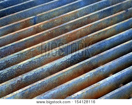Industrial metal grille pattern in grey blue with oxidized rust. poster