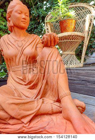 Beautiful Quan Yin terracotta statue in the garden
