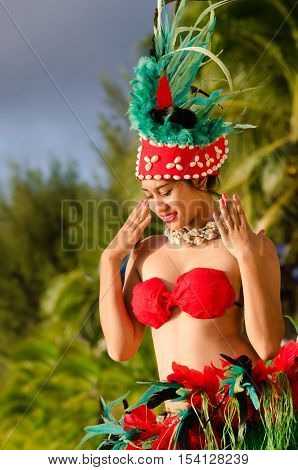 Portrait of Polynesian Pacific Island Tahitian female dancer in colorful costumedancing on tropical beach with palm trees in the background.Photo by Rafael Ben-Ari/Chameleons Eye (Photo have MR)