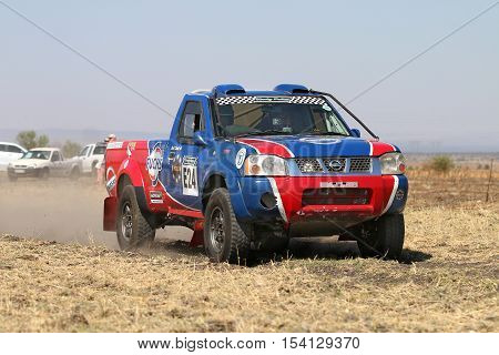 Close-up View Of Speeding Red And Blue Toyota Nissan Single Cab Rally Car