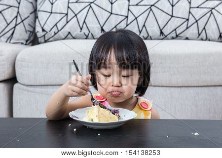 Moody Asian Chinese Little Girl Eating Birthday Cheese Cake