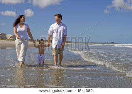 Happy Family On A Beach
