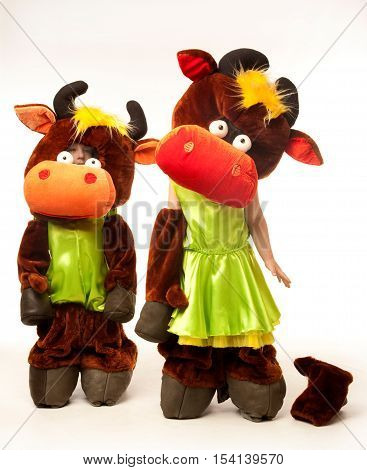 Boy and girl in the funny cow costumes
