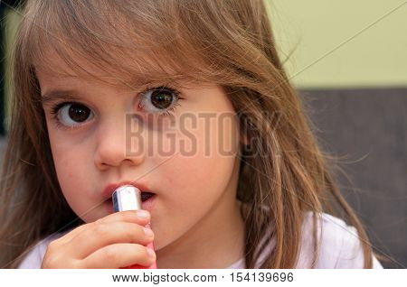 Child Apply Lipstick