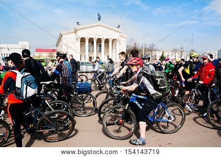 Young People On Bicycles On A Background Of Gomel Drama Theater. Gomel, Belarus