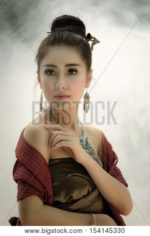 Asia Woman in Thai Traditional Antique Dress of Old Kingdom in Siam