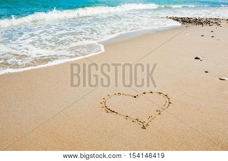 Shape of heart on the beach sea background