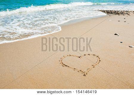 Shape of heart on the beach sea background