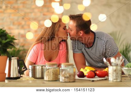 Cooking, love. Lovely couple at kitchen