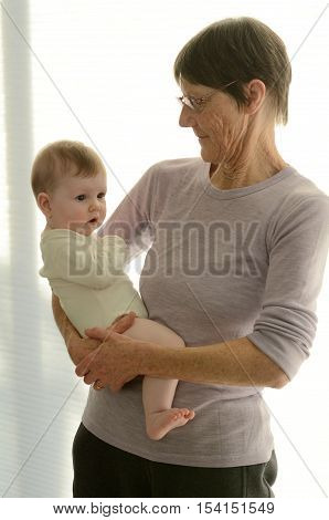 Grandmother Holds Her Grandchild