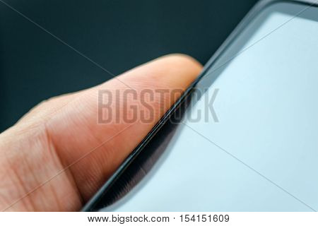 Unlocking smart phone with fingerprint sensor scan close up with selective focus