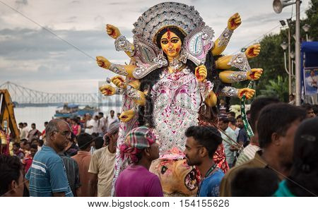 KOLKATA, INDIA - OCTOBER 11, 2016: People throng to witness Durga Puja immersion at Babughat, Kolkata. The Durga idol immersion in the Ganges river marks the end of the five day puja in West Bengal.
