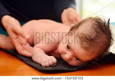 Pediatrician Nurse Checks Infant Baby