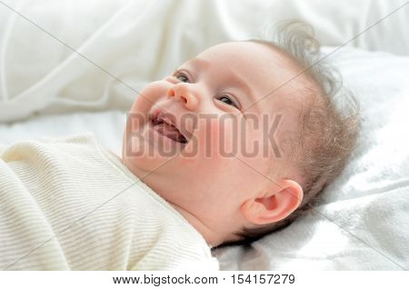 Face Of A Newborn Baby Smile