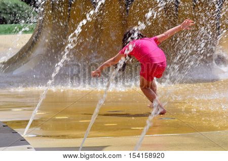 Child Play With Water Fountain.