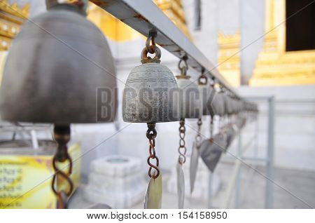 Bells Of Reincarnation Or Samsara In A Pagoda In Thailand