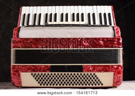 Mother Of Pearl Accordion On A Black Background
