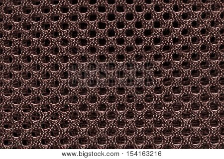 Red brown fishnet cloth material as a texture background. Nylon texture pattern or nylon background for design with copy space for text or image.