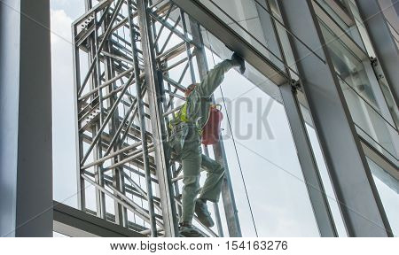 Cleaning crew at airport, window cleaning, cleaning window service on high-rise building.