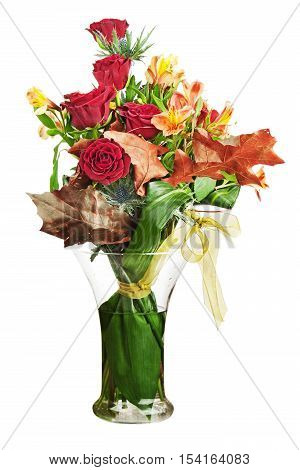 Floral bouquet of roses and lilies arrangement centerpiece in vase isolated on white background. Closeup.