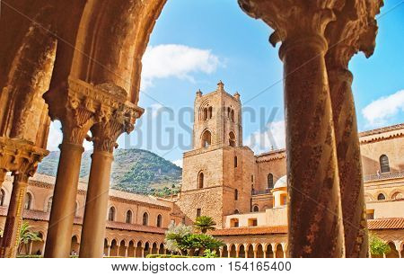 MONREALE ITALY - OCTOBER 10 2016: The shady arcade in garden of Monreale Cloister is the nice place to enjoy the medieval art and architecture on October 10 in Monreale.