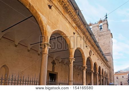 The portico of Monreale Cathedral with the view on its medieval bell tower on the background Sicily Italy.