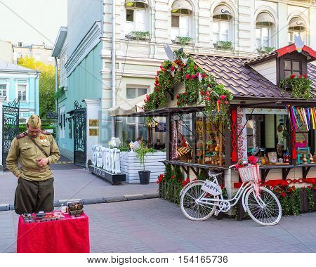 MOSCOW RUSSIA - MAY 10 2015: The market in Arbat street during the celebration of Victory Day on May 10 in Moscow.